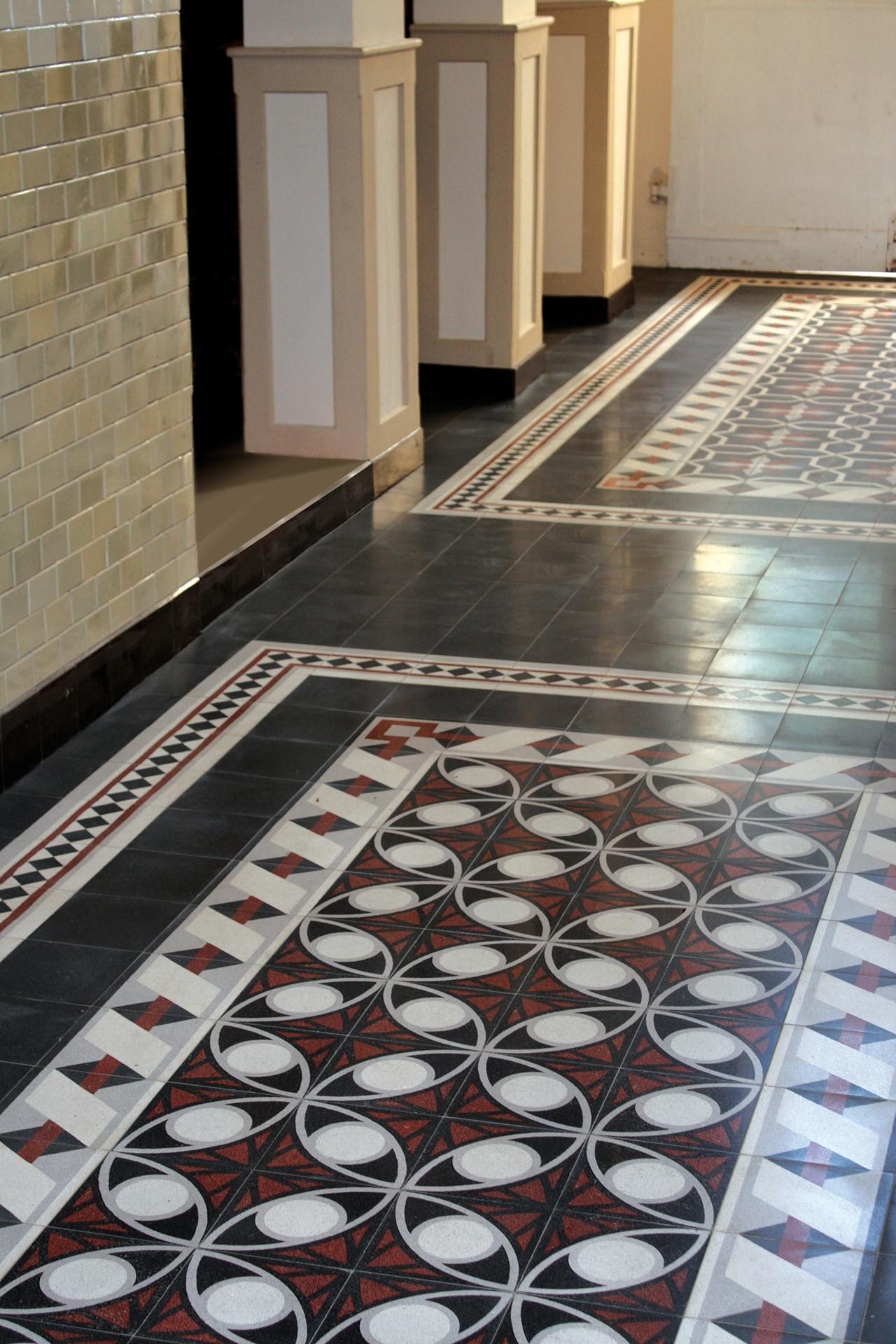 VIA Terrazzoplatte N° 710601 rot, weiß und graues Muster auf schwarzem Grund